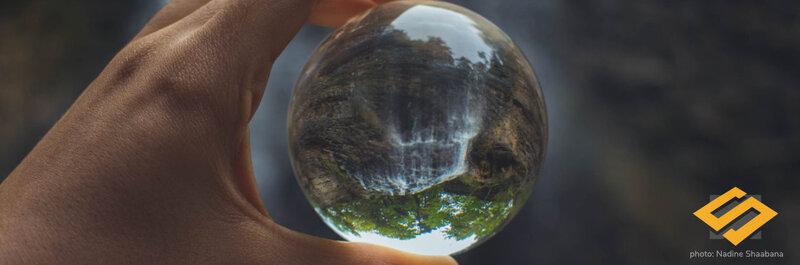 a glass globe showing a waterfall
