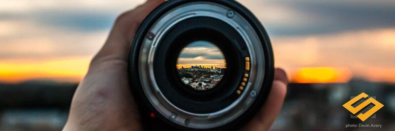 city viewed through a camera lens